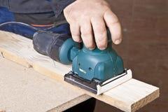 Work with sanding machine Stock Photos