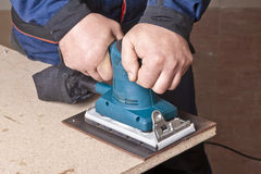 Work with sanding machine Stock Images