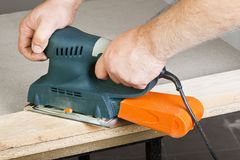 Work with sanding machine Royalty Free Stock Images