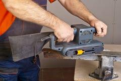 Work with sanding machine Stock Photo