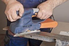 Work with sanding machine Stock Image