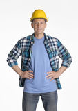 Work satisfaction. Young and happy construction worker portrait holding his helmet Royalty Free Stock Images