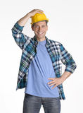 Work satisfaction. Young and happy construction worker portrait holding his helmet Royalty Free Stock Photo