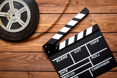 Work screenwriter on wooden background top view.  Royalty Free Stock Photography