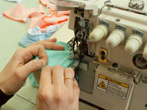 Work on the sewing equipment (close up) Royalty Free Stock Photos