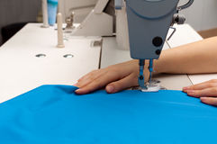 Work at the sewing machine Stock Photos