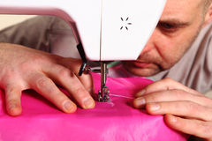 Hand sewing, Thread a needle Stock Image