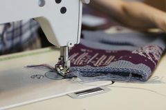 Work in sewing shop at textile factory, close-up Stock Photo