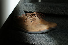 Work shoes. Brown shoes on the stairs Royalty Free Stock Photo