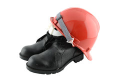 Work shoes and hats safety Royalty Free Stock Image