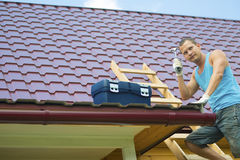 When work should definitely ponder. Work to repair the roof of thinking Stock Photo