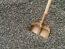 Work - Shovel in a pile of crushed stone. Grey crushed ledge stone gravel with a coal shovel stock photos
