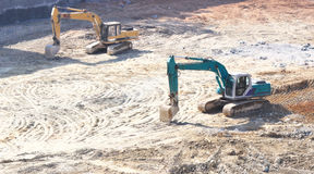 Work site. Two excavators at groundwork work site Royalty Free Stock Photos
