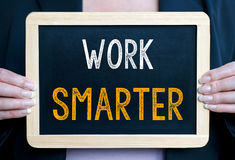 Work smarter - businesswoman with chalkboard Royalty Free Stock Photography