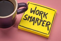 Work smarter inspirational reminder note. Work smarter inspirational advice or reminder - handwriting on a sticky note with a cup of coffee stock photos
