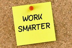 Work Smarter PostIt Note Pinned To Cork Board. Or corkboard Stock Photography