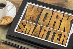 Work smarter- wood type text on tablet Royalty Free Stock Photo