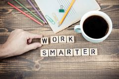 Work Smarter. Wooden letters on the office desk royalty free stock photos