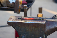 Work of the smith in a smithy.  The heated preparation for a horseshoe. Royalty Free Stock Photos