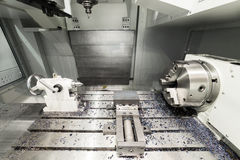Work space of modern CNC milling machine. Working area of modern double-spindle CNC metalworking machine Stock Photos
