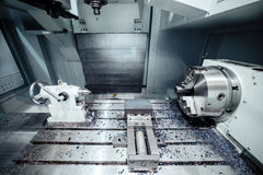 Work space of modern CNC milling machine. Working area of modern double-spindle CNC metalworking machine. Abstract industrial background Stock Image