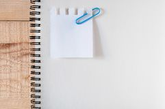 Work space ,notepaper ,sketch book with clips paper,stationery on wooden table. list do it ,Suitable for special occasion.Flat lay. Top view stock photography