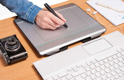 Work space for photographer hand drawing on tablet Royalty Free Stock Photos