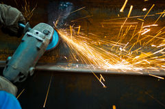 Work when the spark grinding machine Stock Photos
