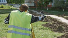 The work of special equipment in the repair of roads. Of the surveyor during the measure of distance in road stock video footage