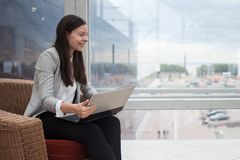 Work in an it startup. Young woman in business casual clothes