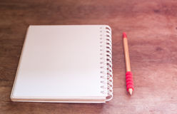 Work station with notebook and pencil with vintage filter Royalty Free Stock Images