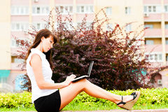 Work on the street. Business woman working with netbook Royalty Free Stock Photography