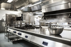 Work surface and kitchen equipment. In professional kitchen Royalty Free Stock Image