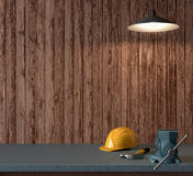 Work table of a carpenter, helmet and hammer on wooden wall back Royalty Free Stock Photos