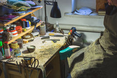 Work table of a cobbler. Artisan sitting in front of his workplace with all tools he needs royalty free stock photos