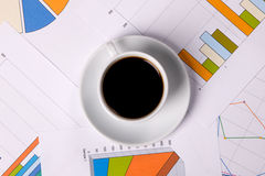 Work-table covered with documents and coffee Stock Image