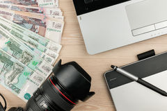 Work table designer, photographer and earned money rubles. View from above Royalty Free Stock Photo