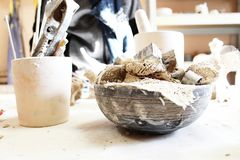 Work table with pottery tools vintage. Colors stock photo