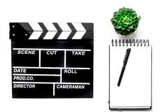 Work table of producer. Movie clapperboard and notebook on white background top view Stock Photography