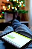 Work on the tablet and the rest on the couch Stock Images