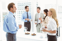 Work team during break time in office Royalty Free Stock Image