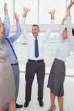Work team cheering together Stock Images