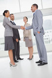 Work team shaking hand with their new partner Royalty Free Stock Photos