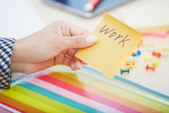 Work text on adhesive note Royalty Free Stock Images
