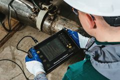 Work thiw ultrasonic flaw detector stock image