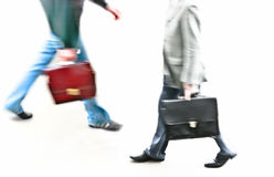 Work time. Two different businessmen in blurry walking Royalty Free Stock Images