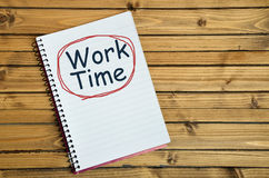 Work time word on notebook Royalty Free Stock Photos