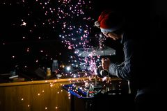 Work on Titanium with angle Grinder and a xmas beanie... stock photos