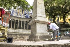 Work to clean vandalism graffiti, waterproof and restore the Obelisco da Memoria stock images