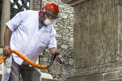 Work to clean vandalism graffiti, waterproof and restore the Obelisco da Memoria royalty free stock image